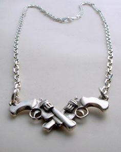 This is cool! Sterling Silver Necklace Crossed Guns by LuladarkJewels on Etsy, $91.00