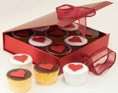 Nine delicious Love Heart cupcakes, in a choice of two flavours. Each cupcake is decorated with an edible red love heart. Presented in this beautiful metallic red Valentine gift box, tied with a ribbon bow. Perfect to send as a Valentine gift for your loved one on Valentine's day this year!     http://www.caketoppers.co.uk/index.asp?Item=gift-boxed-valentine-love-heart-cupcakes--61640567