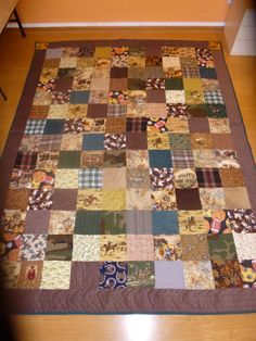 Brown Patchwork Quilt features sports, horses and army men fabrics