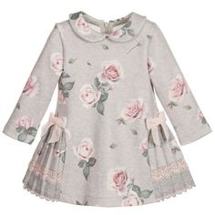 Girls pretty pink rose printed, long-sleeved grey dress by Lapin House. Made with super soft jersey, fastening with a concealed zip at the back. It has pretty pleating from the hips and round the back, trimmed with grey and pink lace. Dresses Kids Girl, Little Girl Dresses, Children Dress, Toddler Dress, Baby Dress, Little Girl Fashion, Kids Fashion, Baby Frocks Designs, Dress Anak