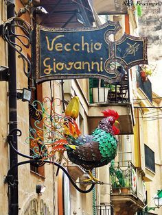 A restaurant in Palma de Mallorca, Majorca, Spain Storefront Signage, Pub Signs, Chicken Art, Business Signs, Advertising Signs, Store Signs, Hanging Signs, Store Fronts, Sign Design
