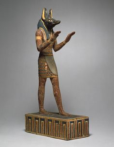 Statuette of the god Anubis as embalmer, Ptolemaic Period, ca. 332–30 B.C. Egyptian Wood with gesso and paint