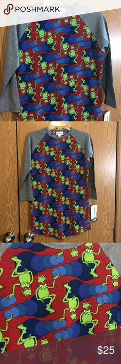 LuLaRoe Randy Shirt Disney Kermit Size XXS TOO CUTE!! I have two of these. My six-year-old daughter wears hers as a dress with a belt and it works great! Runs true to size. Patterned body with grey sleeves. 3/4 Sleeve baseball tee style shirt. Smoke free home. LuLaRoe Tops Tees - Short Sleeve