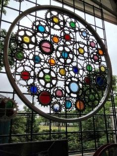 Stained glass bicycle wheel----make one as trellis by alyssa