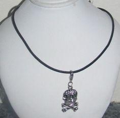 Black hemp necklace with silver skeleton skull charm