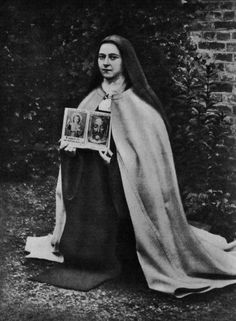 """djinn-gallery: """"SaintTherese The Little Flower, shortly before her death, displaying the cherished objects of her favorite devotion—the Child Jesus and the Holy Face. """""""
