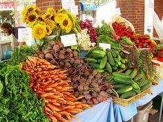 Stacked and colorful fresh Farmer's Market food makes me smile.