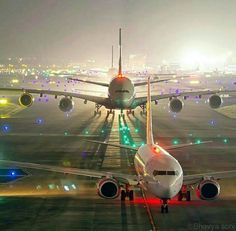 Amazing night line-up at Mumbai Intl. Airport with Boeing B737-800, Airbus A320 and 2 Airbus A380's