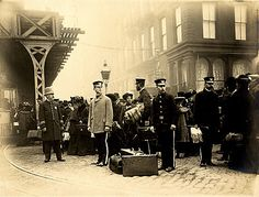 Crowd with Luggage at El and Trolley Tracks, New York City, 1895–1905.