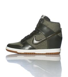 new styles a62d8 12638 NIKE High top women s wedge sneaker Lace up closure Mesh for breathability  Padded tongue with NIKE logo Cushioned inner sole Greyish khaki color