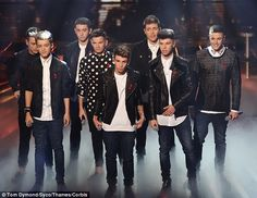 New member: Stereo Kicks nearly became a nine-piece band after an invader jumped on stage while they were performing on The X Factor on Saturday night