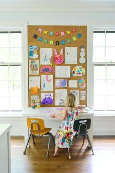 Install an oversized cork board for your child to decorate with their creations.