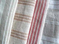 Antique ticking fabric:  2 middles fabrics for pillows to introduce an accent color (red) and pull in gold