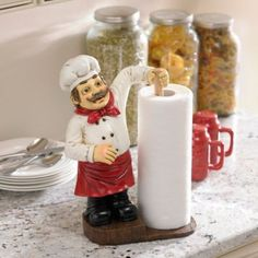 This Chef Paper Towel Holder will add a tiny sous chef to your kitchen just where you need it. He holds one roll of paper towels at the ready for any clean up! Bistro Kitchen Decor, Fat Chef Kitchen Decor, Kitchen Decor Themes, Kitchen Paper Towel, Decorative Towels, Custom Kitchens, Paper Towel Holder, Utensil Holder, Kitchen Accessories