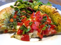Tomato and Basil Pesto Pizza served with simple garden salad
