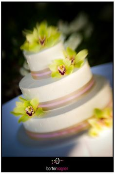 white wedding cake with pink accent and orchids.    borterwagner photography    borterwagner.com