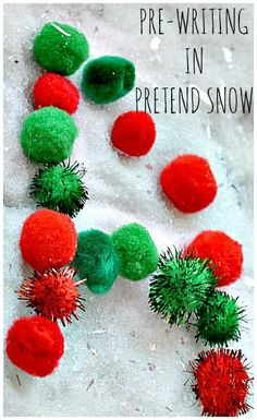 Writing with pom poms on pretend snow from Blog Me Mom. Simple pretend snow recipe included