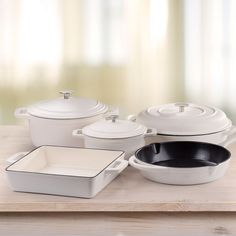 Nouvelle Cast Iron 8Piece Set consisting of:  Casserole- 24cm  Casserole- 18cm  Skillet - 26.5cm  Roaster - 25.6cm  Oven Pan - 30.8cm  Features & Benefits Enamelled Cast Iron Even and intense heat distribution ideal for various cooking styles Made from solid die-