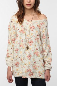 oversized floral sweatshirt + black tights+brown wedged booties = perfect day of the week outfit