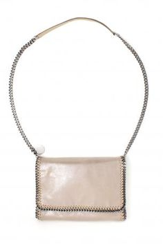 falabella shoulder bag cham beige - shoulder bag / clutch in vegetarian and eco friendly materials in beige color with one silver chain. Magnetic Closure. One zipped pocket inside. Lining in pink fabric with logo. Stella McCartney Spring Summer Collection 2013.