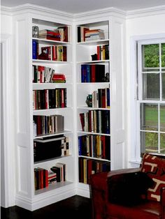 One of two built-in corner bookcase units, crown and base molding to tie-in with room's existing trim. Raised panel sides. Painted cabinets constructed from paint-grade birch plywood and solid poplar face frames.