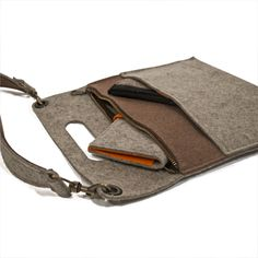 Perfect for everyday use! Created with a slim minimlistic design with two puches for extra storage. Made with 100% natural felt. Measures at 13 IN X 11.9 IN GREY, BROWN