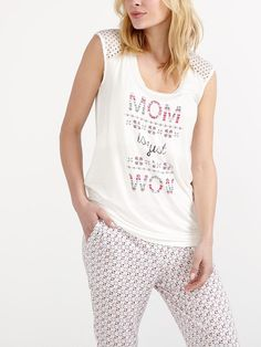 """Get a good night's sleep in comfort and style thanks to this maternity pyjama top! You'll love its super cozy modal blend fabric, as well as its cute lace cap sleeves, cute print at front and rounded neck with inner nursing feature that allows you to breastfeed baby. Team it with any PJ pant from our collection!<br /><br />- Length: 29"""" at front, 28'' at back<br />- Easy nursing access<br />- Can be worn during p..."""
