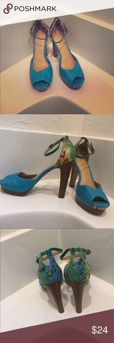 Nine West turquoise heels Turquoise heels man made leather, brown heel base and heel. Includes a ombré snake design on back sole Nine West Shoes Heels