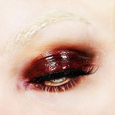 shiny red eye make up, bleached brows