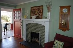 Very nice white mantel surround makes this old brick fireplace the center of attention.
