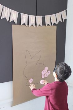 "Pin the Tail on the Bunny game from a ""Somebunny is Two"" Farm Birthday Party on Kara's Party Ideas 