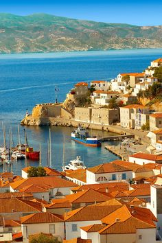 """The historic port of Hydra,  Greek Saronic Islands / Hydra is one of the Saronic Islands of Greece, located in the Aegean Sea between the Saronic Gulf and the Argolic Gulf. It is separated from the Peloponnese by narrow strip of water. In ancient times, the island was known as Hydrea (Υδρέα, derived from the Greek word for """"water""""), which was a reference to the springs on the island."""