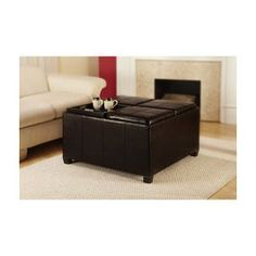 Storage Leather Ottomon with red couches for living room