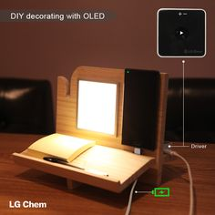 With an LG Display light panel and a 5-pin dual mobile charger, you can create a decorative desk mood lamp that also serves as a desk organizer and a mobile phone charger. Check out Organic Lights at http://www.organic-lights.com/en/lg-display-do-it-yourself-kit.html