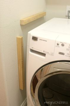 I've been meaning to share with you guys how I built in the washer and dryer for a few weeks now. Summer is good for many things. Being a productive blogger it is not. I don't know if I should call this project a built in washer and dryer or a washer and dryer folding …