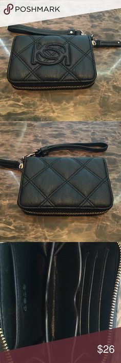 Black Bebe Wallet Really cute wallet! It has a zipper as well and a handle for you to put around your wrist. bebe Bags Clutches & Wristlets