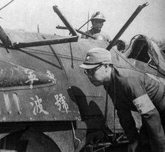 Japanese army reporter looking at a shot down Chinese fighter (Shanghai 1937)