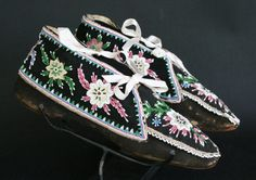 Wyandot (Huron) Moccasins c. 1850 Partially beaded with classic floral designs on black-dyed buckskin and cloth uppers and extended cuffs, commercial leather soles and white ribbon ties - shown at Morning Star Gallery Native American Moccasins, Native American Clothing, Native American Indians, Native Americans, Indian Beadwork, Native Beadwork, Native American Beadwork, Beaded Moccasins, Morning Star