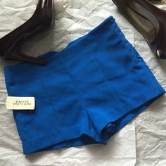 Forever 21 shorts! NWT Forever 21 blue shorts! Royal blue color! Side zipper. Fully lined! Inseam 2 inches! Length 10 inches. Laying flat across waist 13 inches Forever 21 Shorts