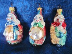 Clown Musician Christmas Ornaments -handcrafted and hand painted.  Each playing a musical instrument. Very bright colors, sparkling glitter!