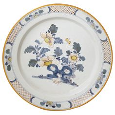 English London delftware pottery charger 18th century | From a unique collection of antique and modern dinner plates at https://www.1stdibs.com/furniture/dining-entertaining/dinner-plates/