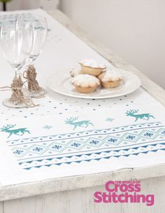 Easy-to-make wintry cross stitched table linen by The World of Cross Stitching, issue195
