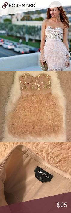 BEBE nude/light pink feather dress with gold studs Gorgeous women's nude/light pink feather dress with gold studs. Removable straps included. Used with love!!! But still in good condition. There are 2 drinks stains on the fabric underneath feathers as shown in last photos - can't really be seen unless you lift the feathers. Close up photos of feathers to show condition but dress still has life to it! Selling as is. Offers are welcomed **Model photo is not mine. Found it online to show how…