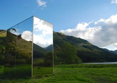 Mirrored cabin in Scottish glen by Angus Ritchie and Daniel Tyler.