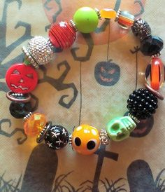 15% OFF! Halloween Bling Bracelet! Sparkly, Shiny, Skull, Pumpkin, Glass and Metal Beads Make this Stretch Bracelet Unique, Fun and Bling! by SerendipitysRarities on Etsy