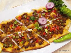 Lahmacun - Turkish Pizza.  When I visit my second home, I am addicted to these!   Roll it up with rocket and tomato - delicious!