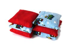 Small #trains dot our flannel bean bags, making a set of #tosstoys that are sure to please the little boys in your life. Bean Bags Light Blue Train & Red Flannel Boys by HandiworkinGirls, $16.95