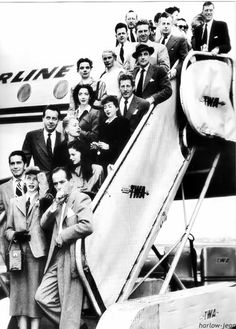 Some of Hollywood's best known actors, including Lauren Bacall , Humphrey Bogart , Danny Kaye , and Gene Kelly, deplane in Washington on their way to protest the investigations of the House Un-American Activities Committee. Communist hysteria led to the blacklisting of hundreds of writers, directors , and actors.