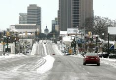 Snow and ice cover the roads in downtown Columbia, S.C., Wednesday, Jan. 29, 2014. Gov. Nikki Haley declared a state of emergency in South C...