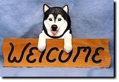 Alaskan Malamute - Dog Breed Welcome Sign Our unique selection of handpainted natural oak Dog Breed Welcome Signs are sure to please the most discriminating Dog Lover! Be the envy of everyone with thi